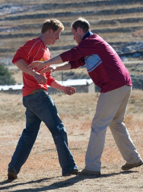 Prince William and Prince Harry play football
