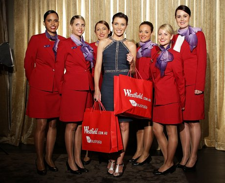 Dannii Minogue with Virgin flight crew