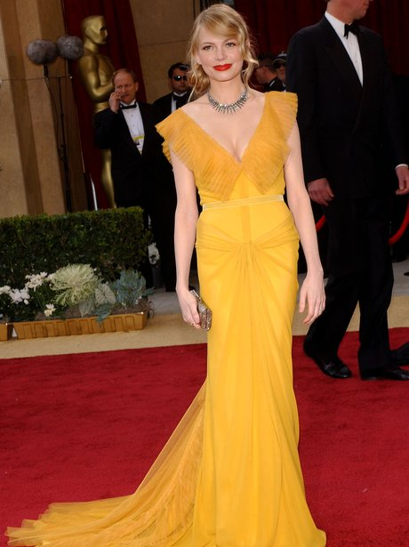 michelle williams at the oscars in a yellow dress