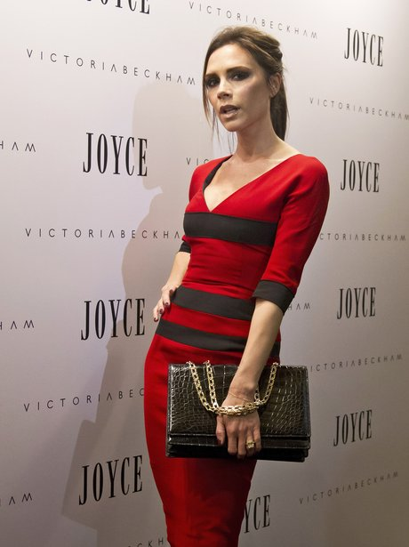 Victoria Beckham on the red carpet in red dress