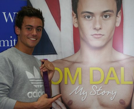 Tom Daley arrives with his Olympic Medal