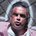 Image 1: Robbie Williams wearing pink suit in Candy video