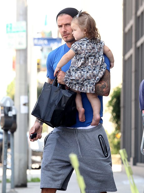 David Beckham carries Harper