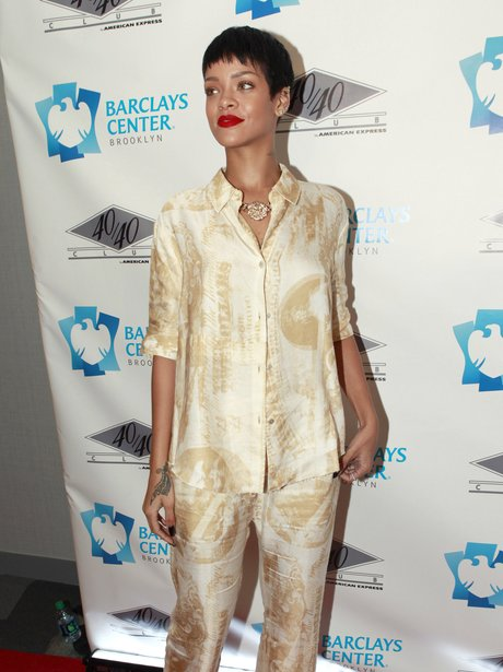 Rihanna wearing a matching silk trouser suit