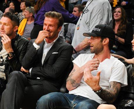 Adam Levine and David Beckham watch basketball