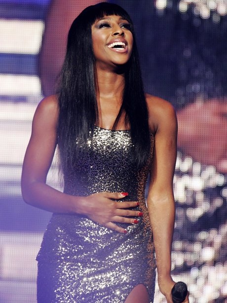 Alexandra Burke laughing on stage