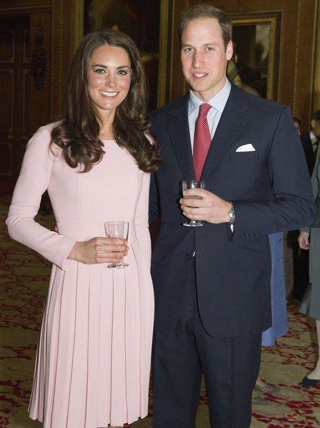 Duke and Duchess of Cambridge holding drinks