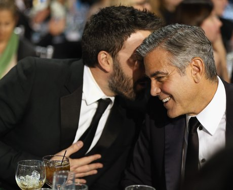George Clooney and Ben Affleck gossiping together at table at the Critics' Choice Awards 2013