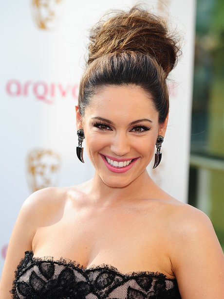 Kelly Brook wearing a top knot