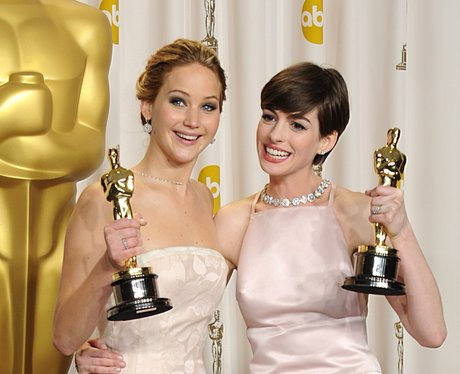 Jennifer Lawrence and Anne Hathaway  at the Oscars