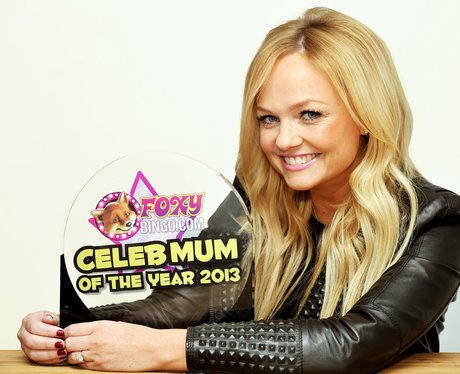 Emma Bunton in a leather jacket with her award