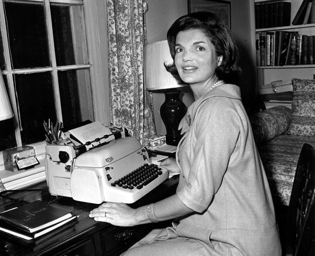 Jacqueline Kennedy poses at her typewriter