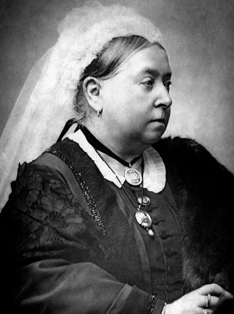 Queen Victoria in later life posing for portrait wearing veil