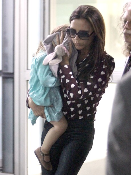 Victoria and Harper Beckham at JFK airport