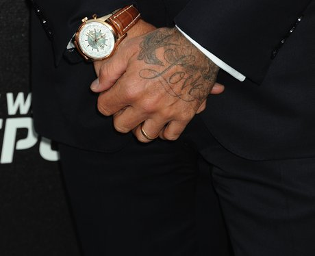 On his left hand the father of four has the word 39 love for Swallow hand tattoo