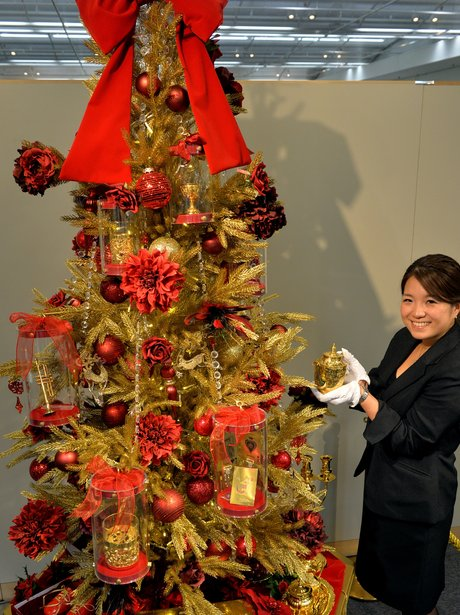 A golden christmas tree, worth £6 million,in Japan