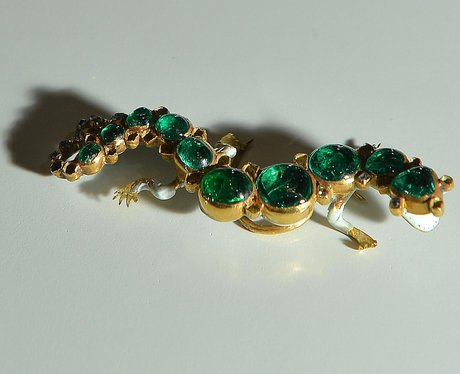 Precious green gem brooch