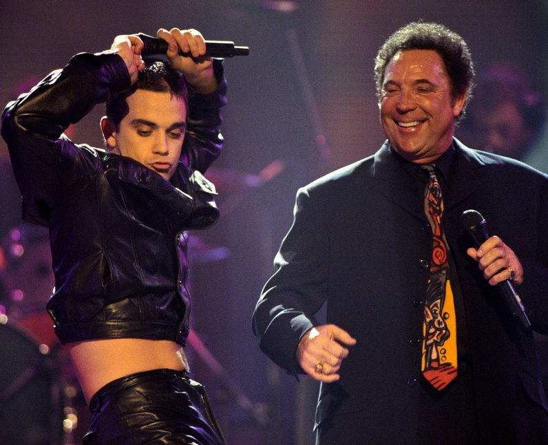 Robbie Williams on stage with Tom Jones at the BRIT Awards 1998