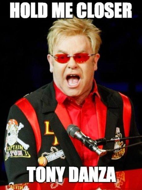 Elton John wears red onstage