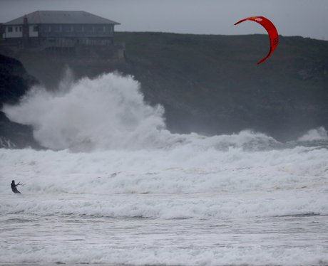 kite surfer rides the waves in cornwall