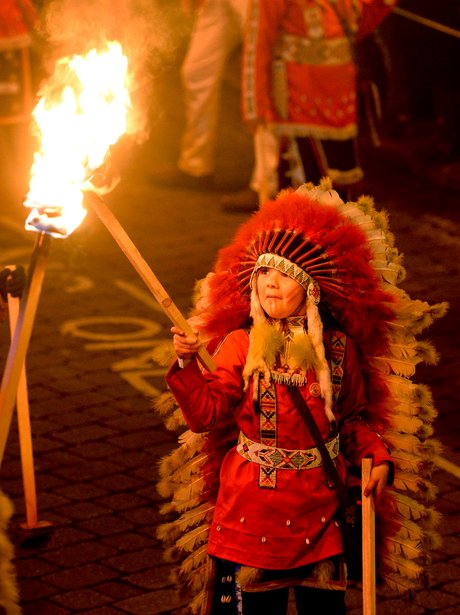 child with torch celebrates bonfire night