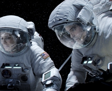 Sandra Bullock and George Clooney in space suits