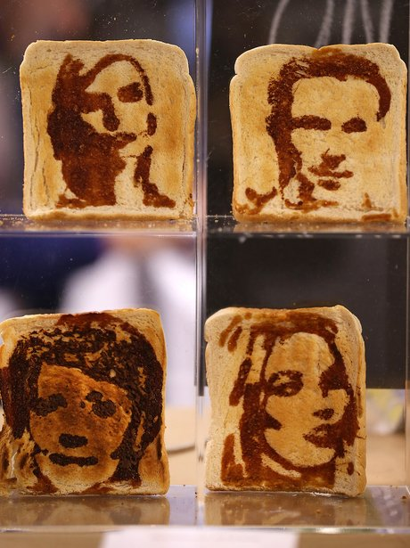 Pieces of toast with celebrities drawn in marmite on them in the Experimental Food Society Exhibition