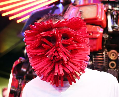 man wearing pegs on his face