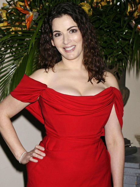 Nigella Lawson shows off her cleavage and breasts in red dress