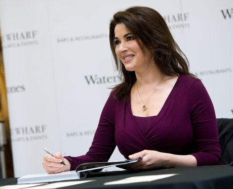 Nigella Lawson signing books in a purple dress