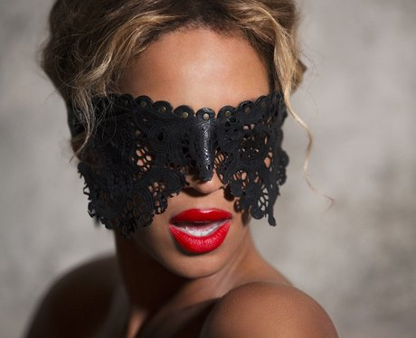 Beyonce wears a black lace eye mask in a promo picture
