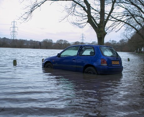 A car in a flooded field