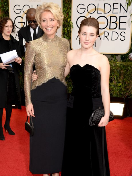 Emma Thompson in a gold and black dress with daughter Gaia