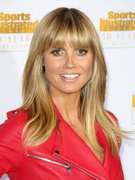Heidi Klum is red hot in a leather jacket at Sports ...  Heidi Klum is r...