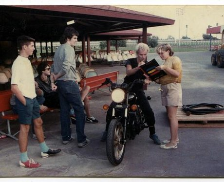 A young Gwen Stefani and Sting on a motorbike