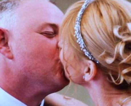 Two people kiss on their wedding day