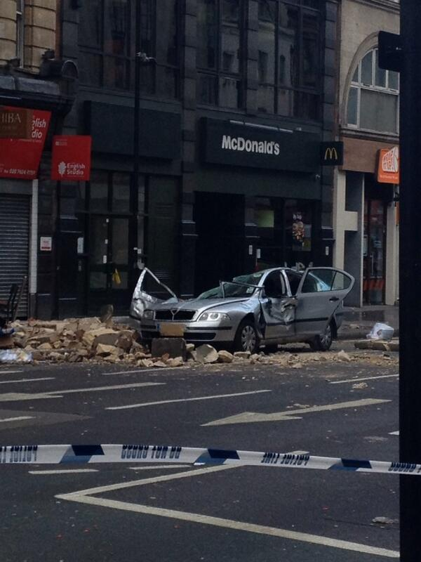 Car crushed in Holborn.