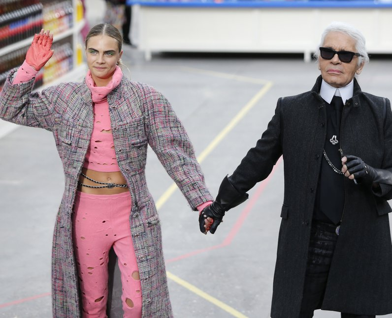 Cara delevigne holding hands with Karl Largerfeld