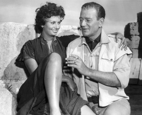 Sophia Loren and John Wayne laughing