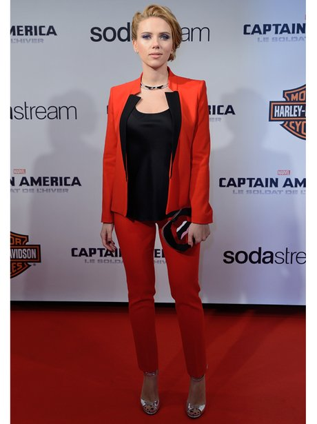 Scarlett Johansson in a matching red blazer and red trousers