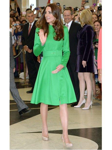 Kate Middleton waving in a green dress