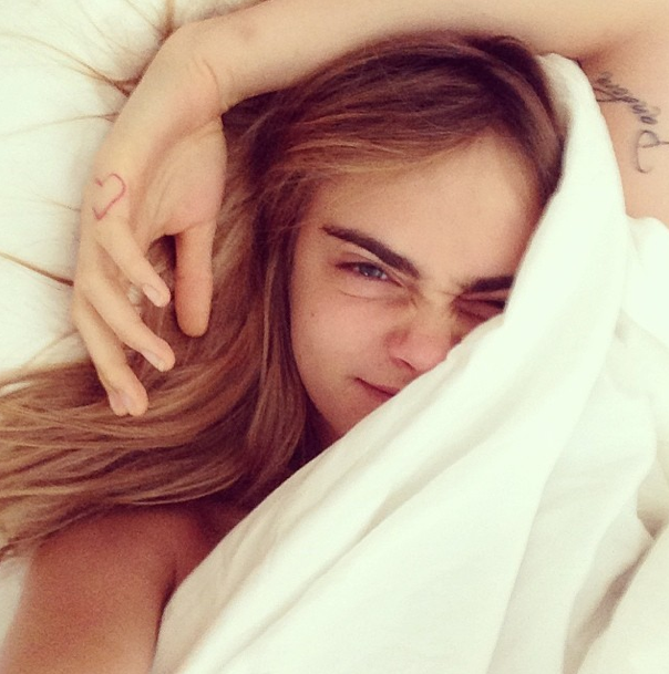 Cara Delevinge in bed without makeup