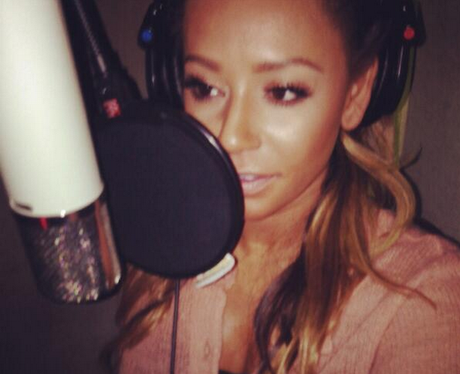 Mel B singing into a mic