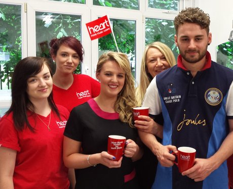 Staff and street team holding mugs and smiling