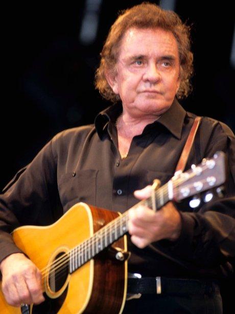 Johnny Cash playing guitar