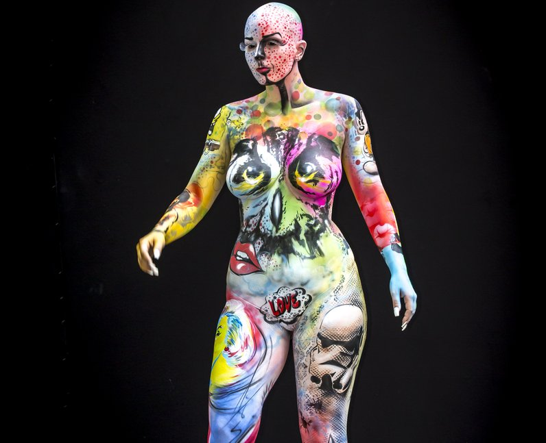 A person covered in body paint