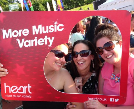 Listeners posing with the frame at Jessie J gig