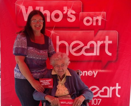 Listeners pose with whos on heart background