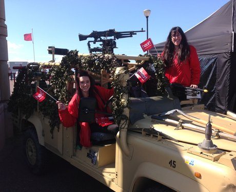 Heart Angels in army car holding flags