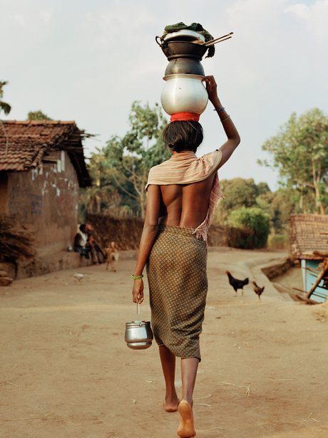 A woman carrying pots on her head